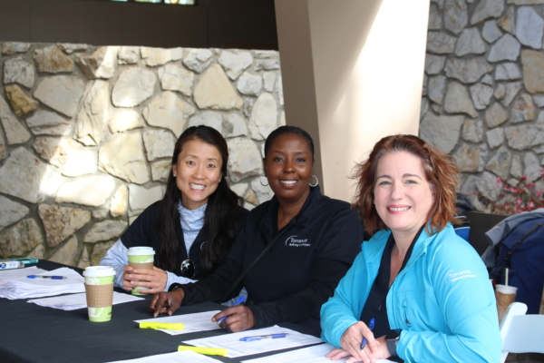 TORC employee volunteers assist with check-in