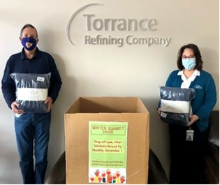 Refinery Manager Steve Steach and Community Relations Manager Barbara donate blankets